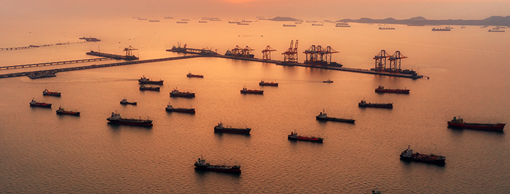 Aerial view Oil ship tanker park on the sea at dusk for transportation crude oil from refinery
